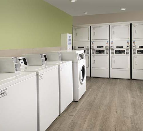 9 WoodSpring Suites Extended Stay Hotel Laundry Room GENERIC 738x456