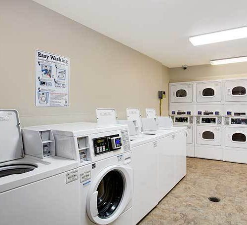 WoodSpring Suites Extended Stay Hotel Rebrand Carpet Generic Laundry Room 738×456~800